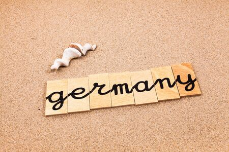 appoints: Words FORMED from small pieces of wood container containing a sun and beach tourist destination Germany