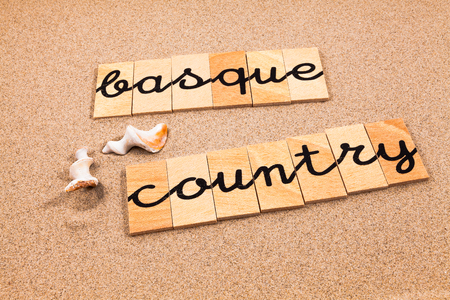 appoints: Words FORMED from small pieces of wood container containing different letters Basque Country