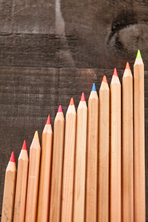 woo: Group colored pencils and They are on wooden background