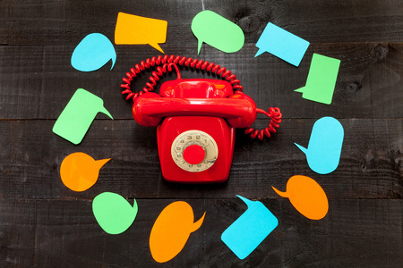 excessive: The telephone and the speech ballons. A red telephone retro speech balloons surrounded by Which Conceptualizing a moment of stress or excessive communication