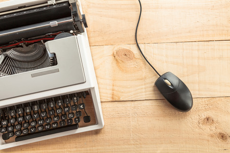 old technology: The picture shows an old typewriter connected to a computer mouse