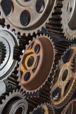friction: Cogwheels machinery, engineering and industry or concepts: such as teamwork and search engine Stock Photo