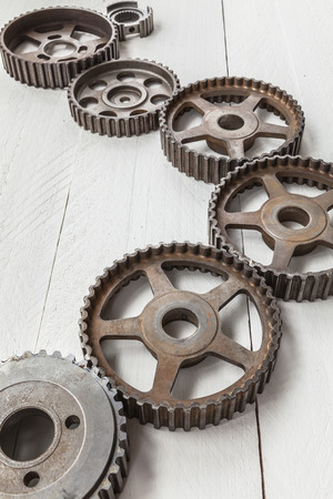 interlock: Cogwheels machinery, engineering and industry or concepts: such as teamwork and search engine on white background