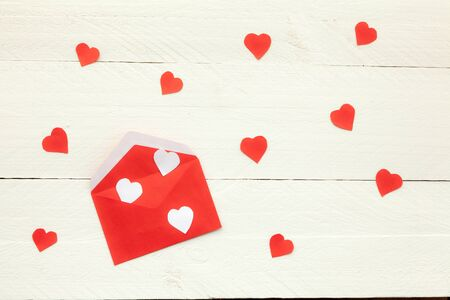 develope: Red develope and black and white hearts on white background Stock Photo