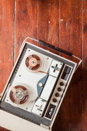 oldie: Old tape recorder on wooden background with natural lighting Stock Photo