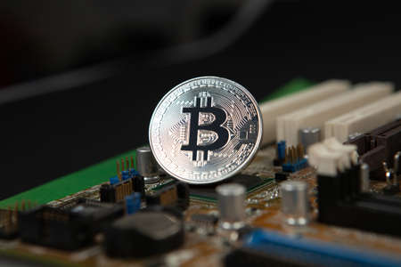 Photograph of bitcoin coins symbolizing the financial market of cryptocurrencies on a colored background and without people