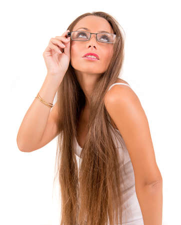 Beautiful woman with glasses looking up in a bwhite background photo