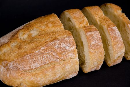 Loaf of bread with three slices separated from it Фото со стока - 720986