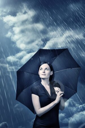 young woman under umbrella photo