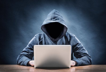 computer security: hacker on a computer