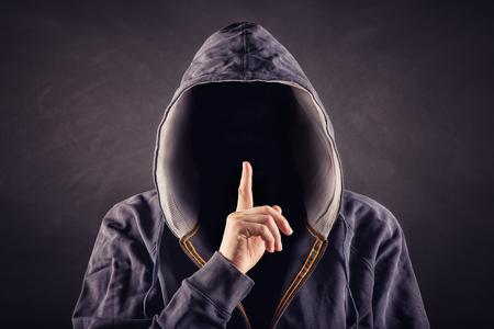 hidden danger: anonymous Stock Photo