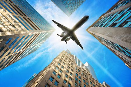upturn: airplane over skyscrapers