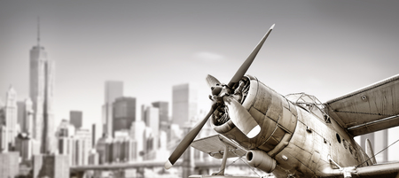 biplane in front of a skyline