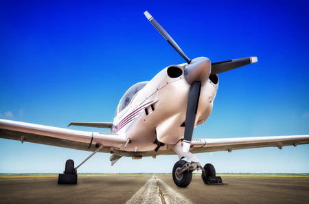 airscrew: sports plane on the runway Stock Photo