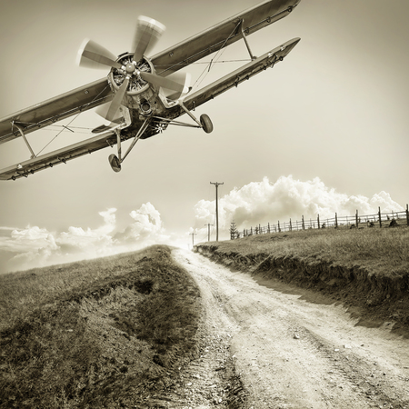 vintage biplane against the sky Stock Photo
