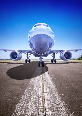 airplane on a runway ready for take off Standard-Bild