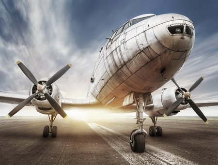 historical airplane on a runway is waiting for takeoff