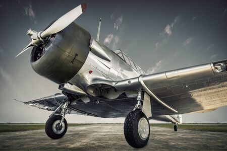 Historical aircraft on a runway is waiting for take off 写真素材