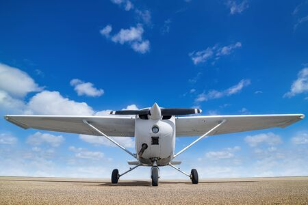 White sports plane against a perfect blue sky
