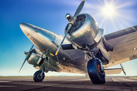 Historical aircraft on a runway is waiting for take off Stok Fotoğraf