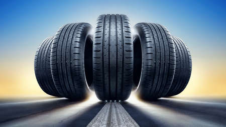 close up of 5 tires against a sunset Stock Photo