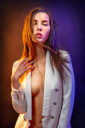 young beauty with long hair colorful illuminated Stockfoto