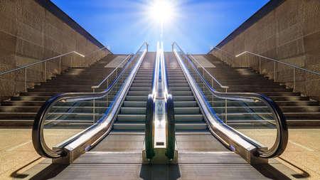 modern escalator against a sunny blue sky