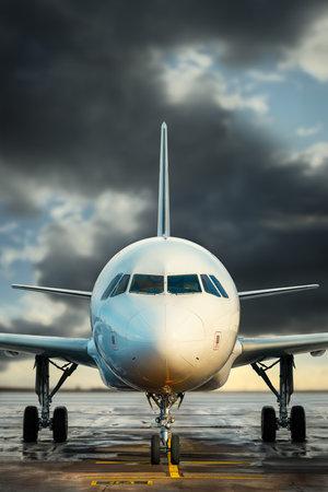 modern airplane against a dramatic sky Stockfoto