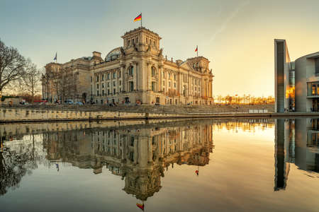 the famous reichstag building in berlin while sunset
