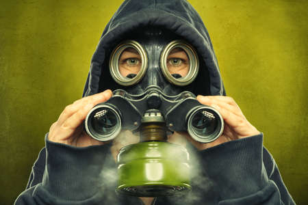 gas masked person is using a spyglass