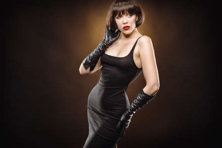 young beauty wearing a black dress and gloves