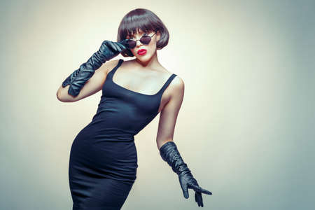 young beauty wearing gloves and sun glasses