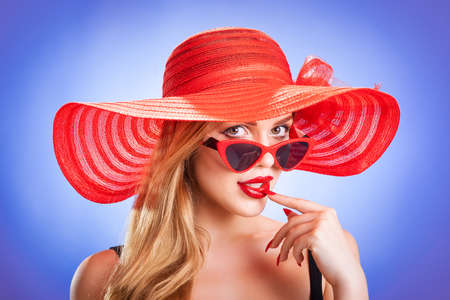 young beauty with a red straw hat Stockfoto