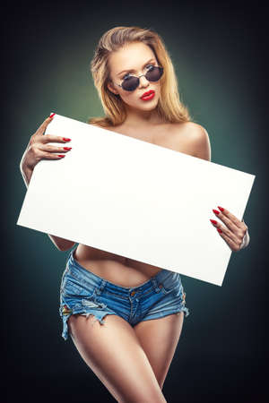 young beauty holding a white board in her hands Stockfoto