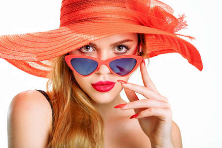 young beauty with a straw hat and sun glasses