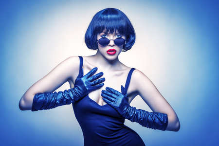 young beauty with sun glasses and gloves Stockfoto