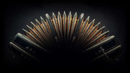 close up of an bandoneon against black