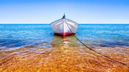 fishing boat on the blue sea Stockfoto