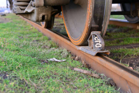 Close-ups Steel diesel railcar train bogie wheels on the tracks. 写真素材