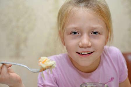 little girl eats cabbage