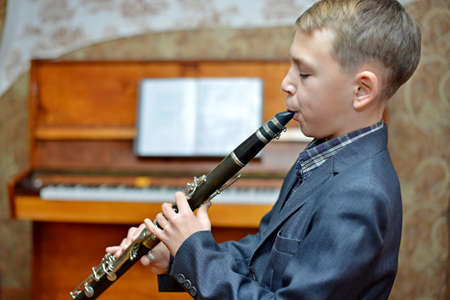 Boy playing the clarinet Stock Photo