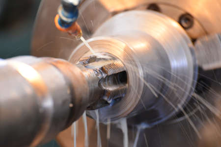 Thread tapping, on the machine with water cooling. Modern manufacturing process.