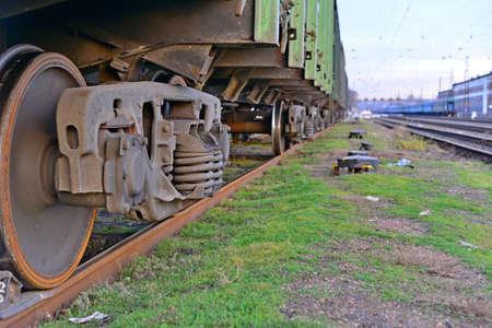 Close-ups Steel diesel railcar train bogie wheels on the tracks. Imagens