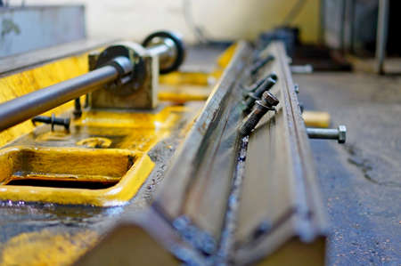 lathe work and engine oil. Repair of lathe, grinding machine, guiding and splined shaft Stock Photo