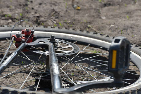 Brake on a bicycle, wheels and knitting needles close-up