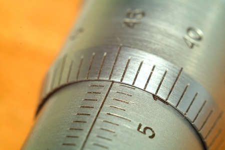Metric system of measurements, scale on a measurer under magnification, millimeter macro.