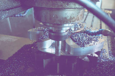 The milling cutter on the CNC machine processes the gear tooth