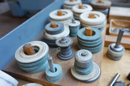 Abrasive grinding wheels on the rack are ready to work.
