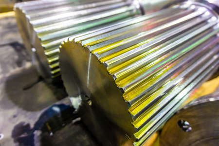 Splined shaft lies on the rack after machining in oil, and is ready for further use in production