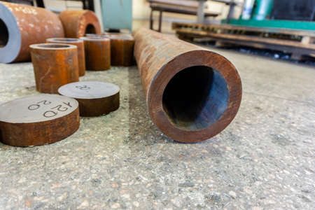Rusty iron pipes for machining, billet for turner